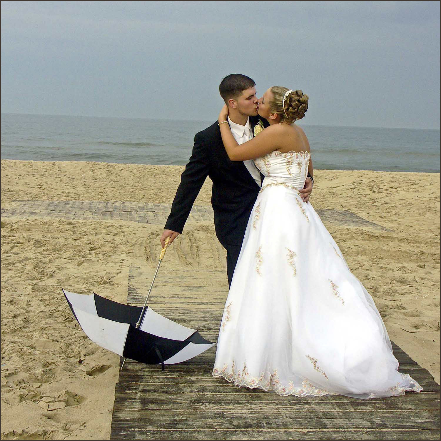 Virginia beach bride and groom kissing