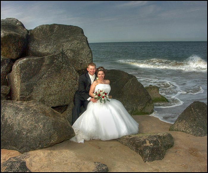 The lowest wedding Photography Prices in Virginia Beach for the The finest wedding photography in virginia Beach , by Diamond Photography , here a bride and Groom pose at Historic Fort Story.